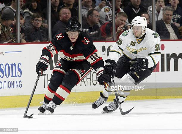 Marian Hossa of the Chicago Blackhawks takes control of the puck as Fabian Brunnstrom of the Dallas Stars approaches from behind on February 09 2010...