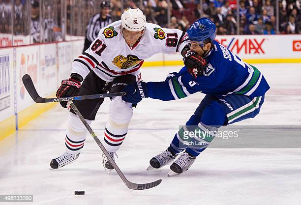 Marian Hossa of the Chicago Blackhawks tries to fight off the check of Luca Sbisa of the Vancouver Canucks in NHL action on November 2015 at Rogers...