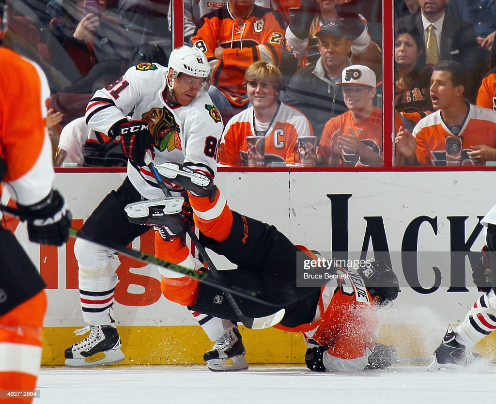 Marian Hossa #81 of the Chicago Blackhawks upends Chris VandeVelde #76 of the Philadelphia Flyers during the third period at the Wells Fargo Center on October 14, 2015 in Philadelphia, Pennsylvania. The Flyers defeated the Blackhawks 3-0.