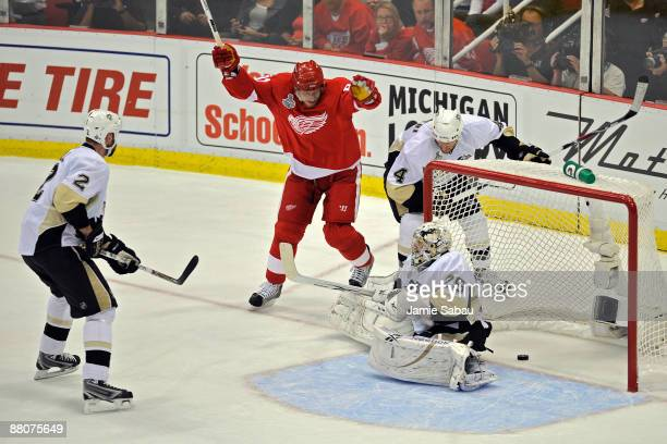 Marian Hossa of the Detroit Red Wings celebrates after scoring a goal in the first period against MarcAndre Fleury Hal Gill and Rob Scuderi of the...