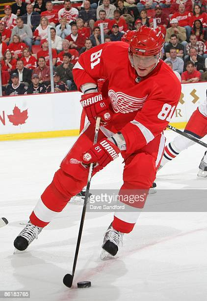 Marian Hossa of the Detroit Red Wings handles the puck against the Columbus Blue Jackets during Game One of the Western Conference Quarterfinals of...