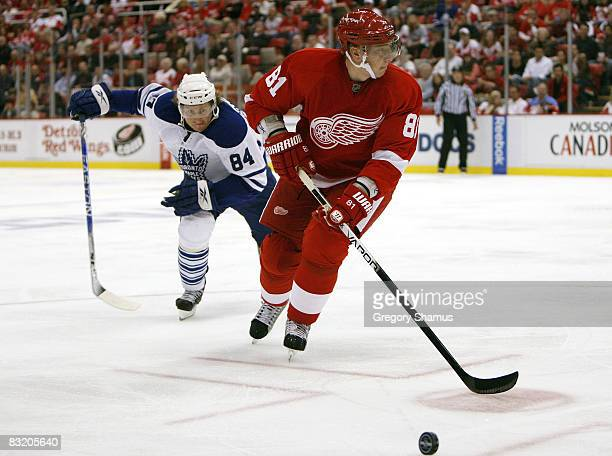 Marian Hossa of the Detroit Red Wings tries to control the puck in front of Mikhail Grabovski of the Toronto Maple Leafs during the second period on...
