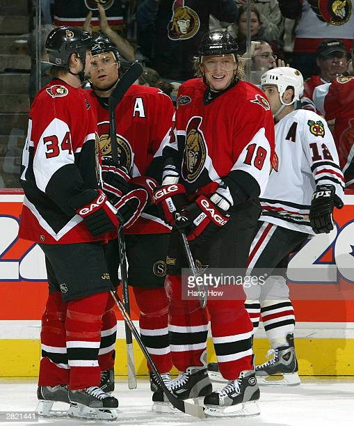 Marian Hossa of the Ottawa Senators celebrates his goal with teammates Curtis Leschyshyn and Shane Hnidy against the Chicago Blackhawks during the...