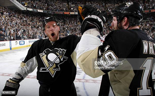Marian Hossa of the Pittsburgh Penguins celebrates with Ryan Whitney after a 3-2 overtime win against the New York Rangers in game five of the 2008...