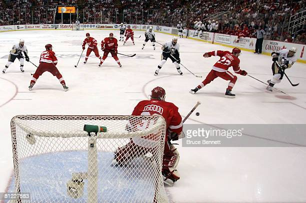 Marian Hossa of the Pittsburgh Penguins shoots the puck against goaltender Chris Osgood of the Detroit Red Wings during game one of the 2008 NHL...