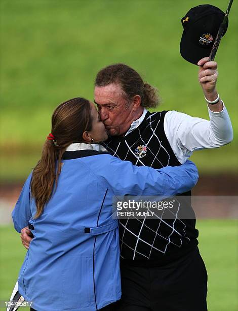 Marian Jimenez wife of Europe Ryder Cup player Miguel Angel Jimenez embraces him on the 18th green after Jimenez and teammate Peter Hanson beat US...