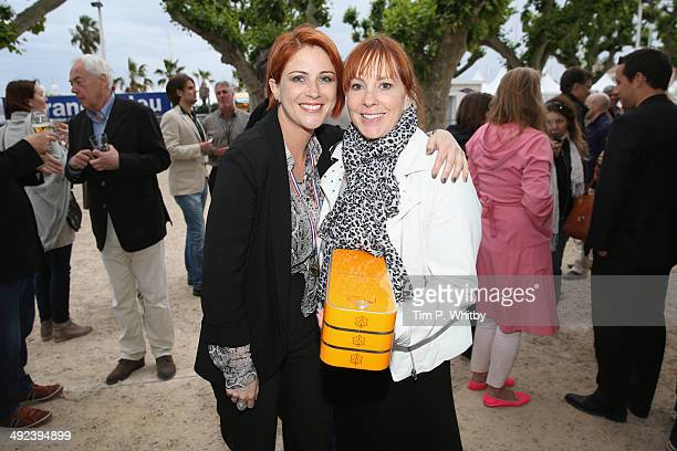 Marian O'Hanlon and Noel Lohr attend The Fintage House Akin Gump Annual Boules Event at Promenade de la Croisette on May 19 2014 in Cannes France