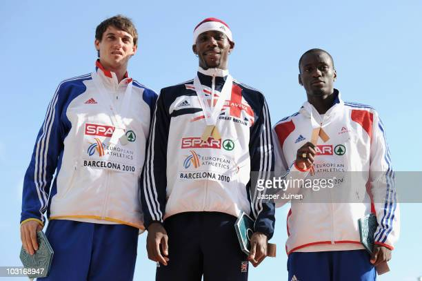Marian Oprea of Romania receives the silver medal Phillips Idowu of Great Britain receives the gold medal and Teddy Tamgho of France receives the...