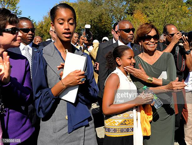 Marian Robinson grandmother to US President Barack Obama's daughters Sasha and Malia and White House advisor Valerie Jarrett applaud the conclusion...