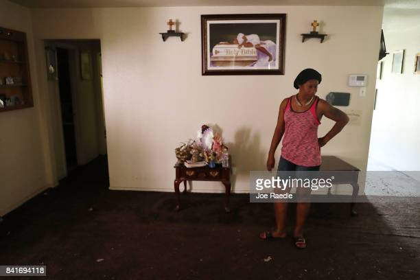 Marian Russell stands in her wet living room as she begins the process of trying to rebuild her life after torrential rains caused widespread...