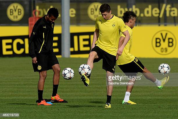 Marian Sarr PierreEmerick Aubameyang and Robert Lewandowski of Borussia Dortmund warm up during their training session at the club's training ground...