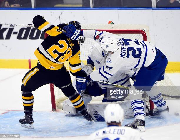Marian Studenic of the Mississauga Steelheads gets pulled down by Jacob Moverare of the Mississauga Steelheads during game action on December 10 2017...