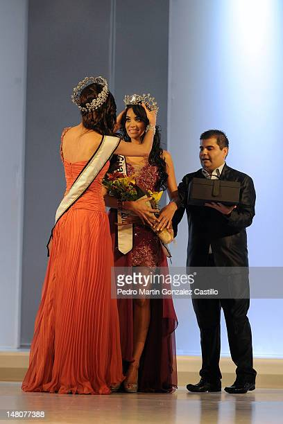Mariana Berumen winner of the 2011 contest and Elisa Espinoza winner of the contest Our Beauty of Guanajuato 2012 pose for the photo during the...