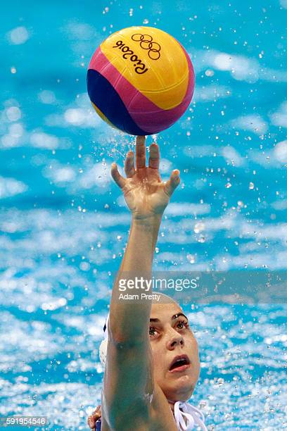 Mariana Duarte of Brazil balances the ball during the Women's Water Polo 7th 8th Classification match between Brazil and China on Day 14 of the Rio...