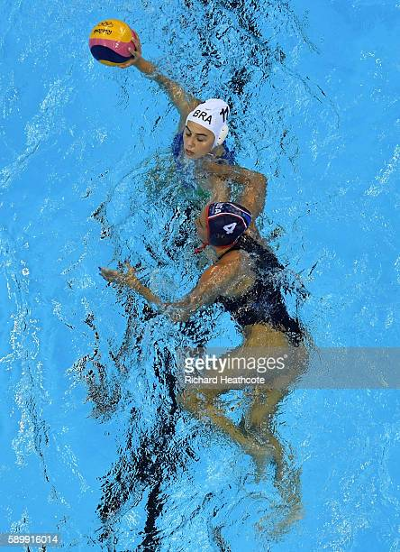 Mariana Duarte of Brazil holds off Rachel Fattal of USA in the Brazil v USA Women's water Polo Quarter Final at Olympic Aquatics Stadium on August 15...