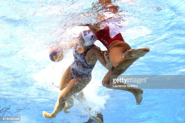 Mariana Duarte of Brazil is challenged during the Women's Water Polo Group A preliminary round match between Brazil and Canada on day seven of the...