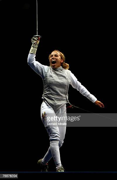 Mariana Gonzalez of Venezula celebrates her team's victory over Canada in the Gold Medal Final of the Women's Team Foil during the XV Pan American...