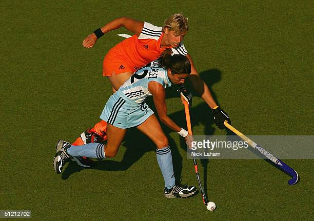 Mariana Gonzalez Olivia of Argentina compete for the ball with in women's field hockey semifinals on August 24 2004 during the Athens 2004 Summer...