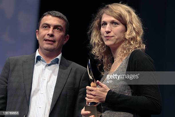 Mariana Grapinet of Paris Match poses after winning the Ouest-France / Jean Marin price for reportage for her coverage of rape victims in the...