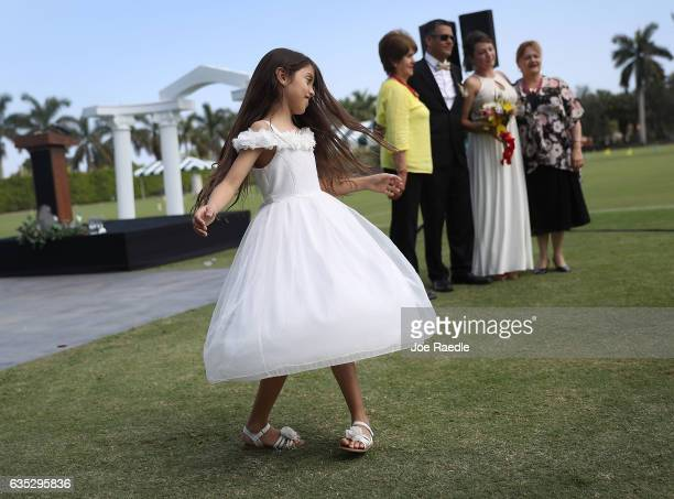 Mariana Guzman spins around after her relatives participated in a group Valentine's day wedding ceremony at the National Croquet Center on February...