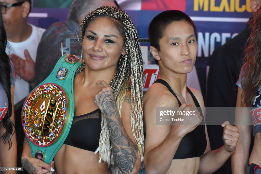 Mariana Juarez 'Barby' and Terumi Nuki pose for photos during a weigh-in on August 10, 2018 in Mexico City, Mexico. Mariana 'Barby' Juarez of Mexico will fight against Terumi Nuki of Japan for the WBA Bantamweight World Championship and Jackie Nava of Mexico will fight Alys Sanchez of Venezuela for the WBA Bantamweight International Championship on August 11.