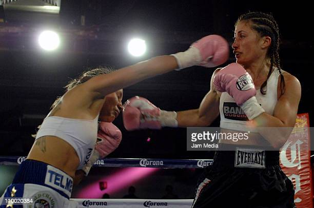 Mariana Juarez of Mexico and Simona Galassi of Italia fight for the female WCB absolute world flyweight Championship during the boxing funtion named...