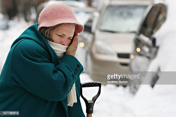 Mariana Kohn from Roscoe NY wipes her brow while shoveling snow away from her car on West 73rd Street on December 28 2010 in New York City Kohn was...