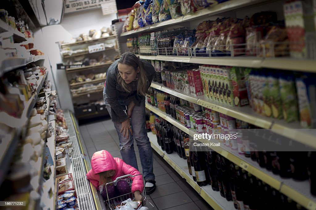 Mariana Kozovik buys food in a Russian supermarket named 'Russia' in Charlottenburg district on October 29, 2013 in Berlin, Germany. According to recently published statistics, 7.2 million foreigners were living in Germany by the end of 2012, which is the highest number ever recorded. Of those 80% are from countries in the European Union, while the rest come primarily from Turkey, Russia, the former Soviet states and Arab countries.