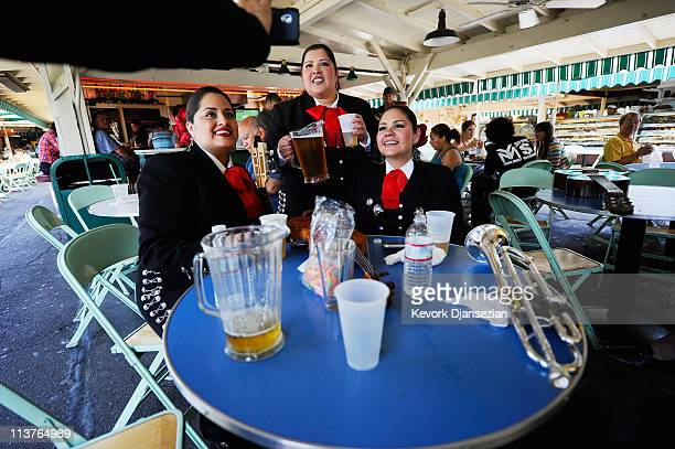 Mariana Nanez Esmeralda Garcia and Judith Merillo members of the allfemale strolling Mariachi band Ellas Son performs at Los Angeles Farmer Market...