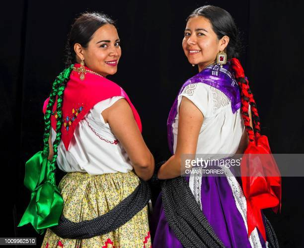 Mariana Nunez and Paulina Canseco rehearse for the Guelaguetza traditional festival in Oaxaca Mexico on July 29 2018 Guelaguetza has its origin in a...