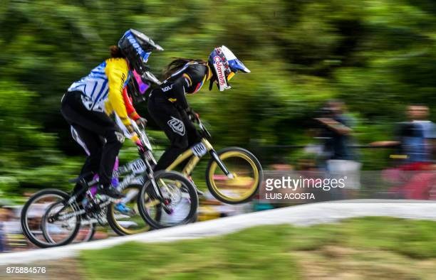 Mariana Pajon of Colombia and Venezuela's Stefany Hernandez compete in the women's BMX 20in final during the XVIII Bolivarian Games 2017 in Santa...