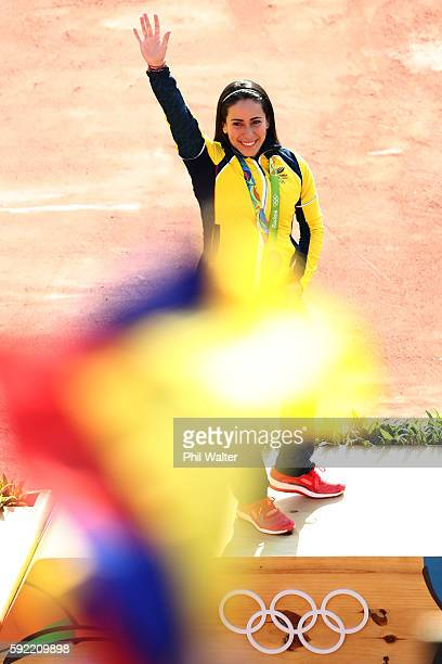 Mariana Pajon of Colombia celebrates on the podium after being presented with her gold medal after winning the Women's BMX Final on day 14 of the Rio...