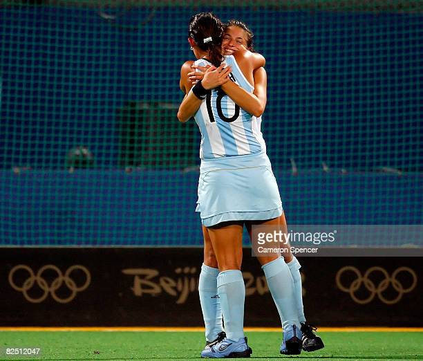 Mariana Rossi and Agustina Soledad Garcia of Argentina hug after their 31 victory over Germany during the women's bronze medal hockey match at the...