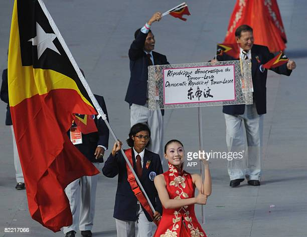 Mariana Ximenes Democratic Republic of TimorLeste's flag bearer parades in front of her delegation during the 2008 Beijing Olympic Games opening...