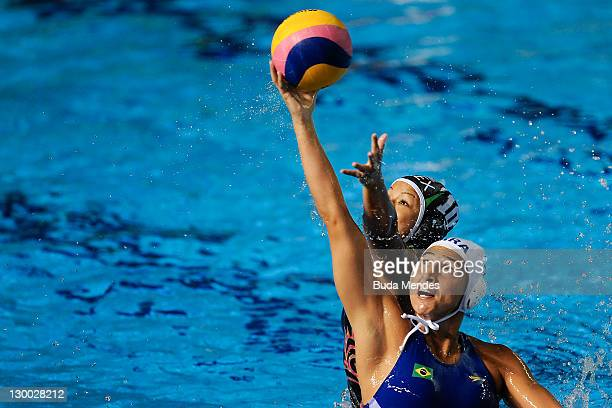 Mariana Zablith of Brazil is challenged against Gisselle Naranjo of Mexico in the Women's Water Polo during the Pan American Games Guadalajara 2011...