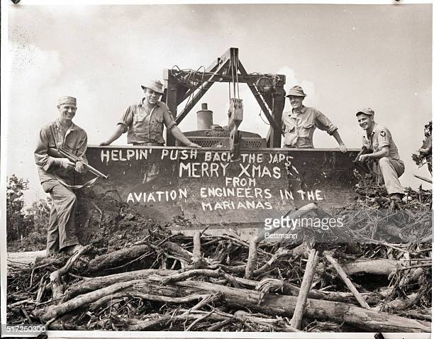 Marianas Aviation engineers working on a B29 base in the Marianas pause in their work long enough to wish the folks back home a Merry Christmas