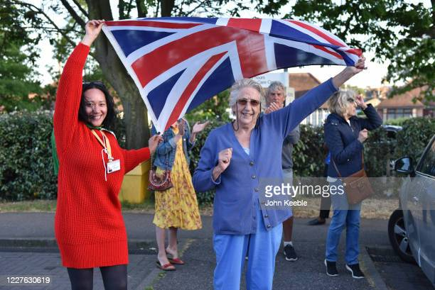 Mariane, Logistics Supervisor and her mother in law hold a Union Jack flag during the clap for carers at the Southend University Hospital on May 28,...