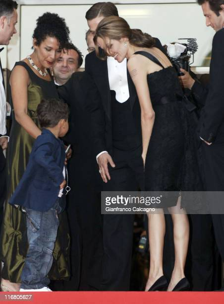 Mariane Pearl widow of slain reporter Daniel Pearl their son Adam Angelina Jolie and Brad Pitt