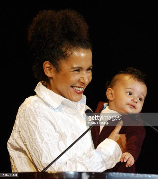 Mariane Pearl widow of slain Wall Street Journal reporter Daniel Pearl and their 4monthold son Adam attend the 13th annual Courage in Journalism...