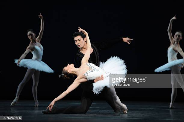 Marianela Nunez and Ryoichi Hirano with artists of the company in The Royal Ballet's production of George Balanchine's Symphony in C at The Royal...