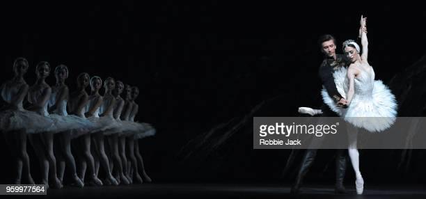 Marianela Nunez as Odette/Odile and Vadim Muntagirov as Prince Siegfried with artists of the company in Liam Scarlett's adaptation of Marius Petipa...