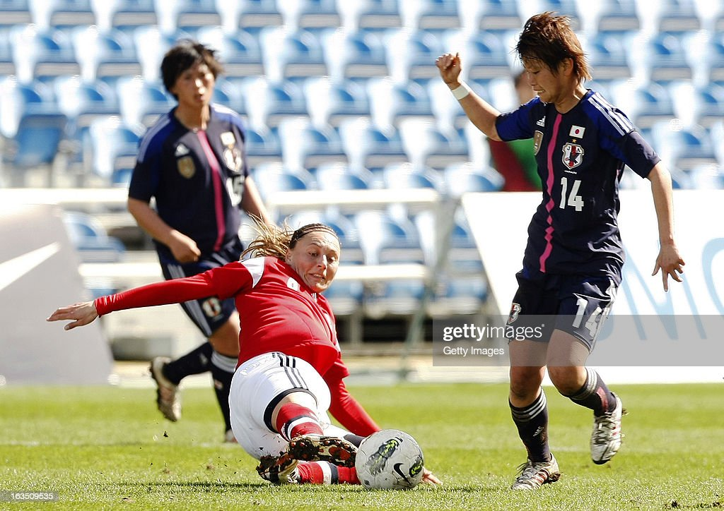 Mariann Gajhede Knudsen (L) of Denmark challenges Asuna Tanaka of Japan during the Algarve Cup 2013 match between Denmark and Japan at the Algarve stadium on March 11, 2013 in Faro, Portugal.