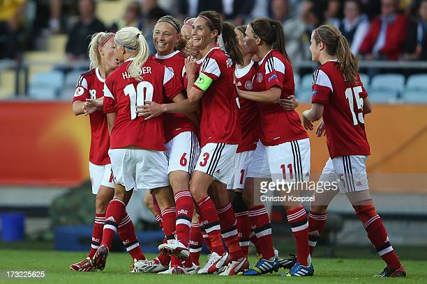 Mariann Knudsen of Denmark celebrates the first goal with team mates during the UEFA Women's EURO 2013 Group A match between Sweden and Denmark at...