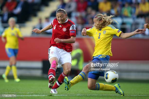 Mariann Knudsen of Denmark scores the first goal against Charlotte Rohlin of Sweden during the UEFA Women's EURO 2013 Group A match between Sweden...
