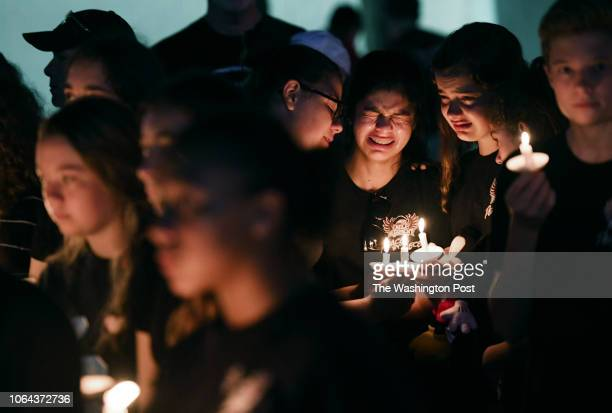 Marianna Guttierez center right and other students of Marjory Stoneman Douglas High School gather with others for a candlelight vigil in honor of the...