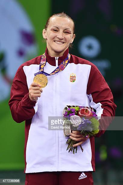 Marianna Sastin of Hungary pose with her gold medal won in the Women's Freestyle 60kg Wrestling Final during day three of the Baku 2015 European...