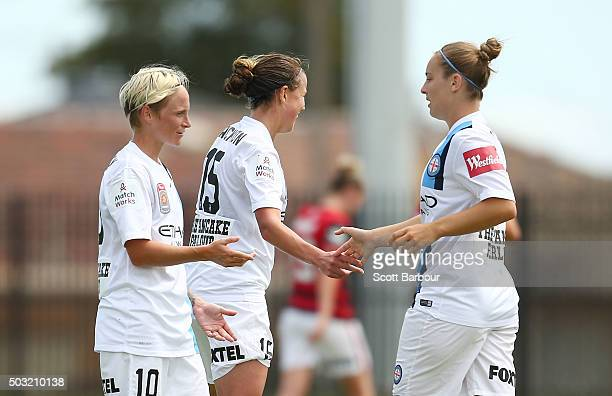 Marianna Tabain of City FC celebrates with Jessica Fishlock and Amy Jackson after scoring the fourth goal during the round 12 WLeague match between...