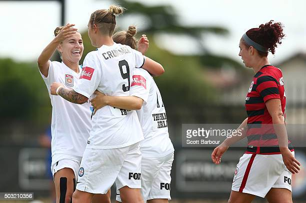 Marianna Tabain of City FC celebrates with Larissa Crummer and Stephanie Catley after scoring the fourth goal during the round 12 WLeague match...