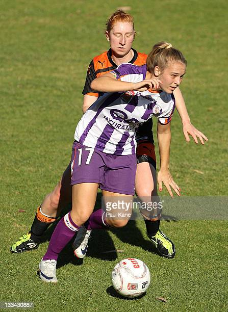 Marianna Tabain of the Glory and Ashley Spina of the Roar contest the ball during the round five WLeague match between the Perth Glory and the...