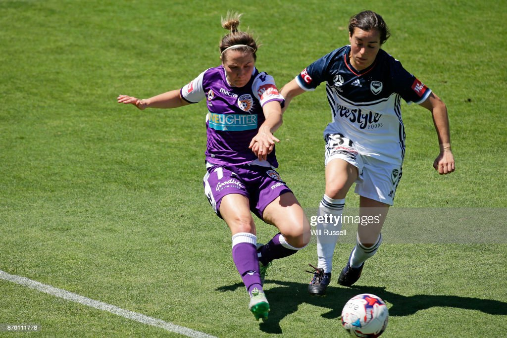 Marianna Tabain of the Glory and Christina Gibbons of the Victory competes for the ball during the round four W-League match between Perth Glory and Melbourne Victory at nib Stadium on November 19, 2017 in Perth, Australia.